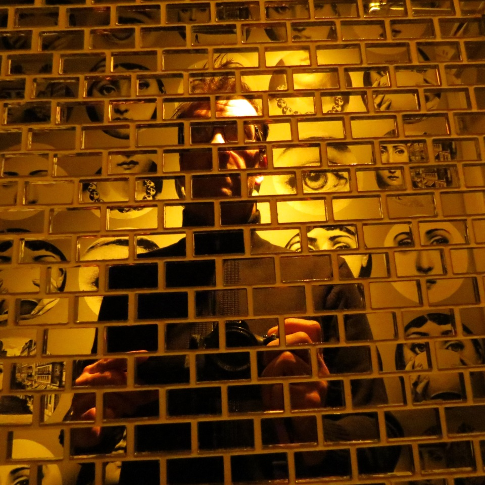 Unedited self portrait in the bathroom of Cafe Bar in Astoria. I could resist the mirror tile of unusual wallpaper and lighting.