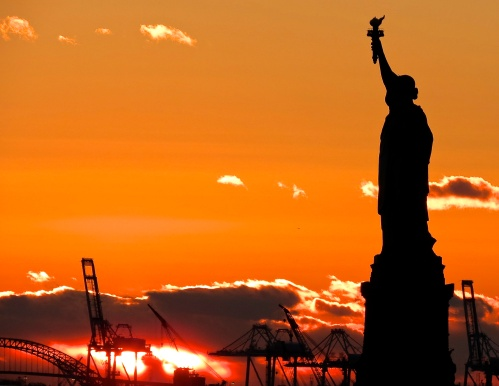 The Statue of Liberty at sunset.