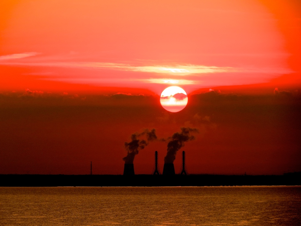 Ominous red sky at sunrise over Russia on the Baltic.