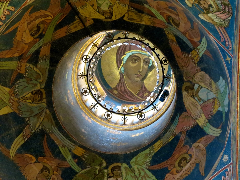 A figure is depicted inside each of the domes.