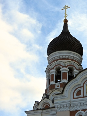 One of the onion domes of the Alexander Nevsky Cathedral against the blue sky in Tallinn.