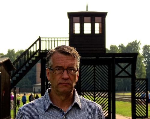Standing outside the Death Gate at Stutthof Concentration Camp.