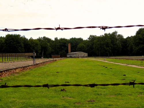 In the distance stands the gas chamber and crematory.