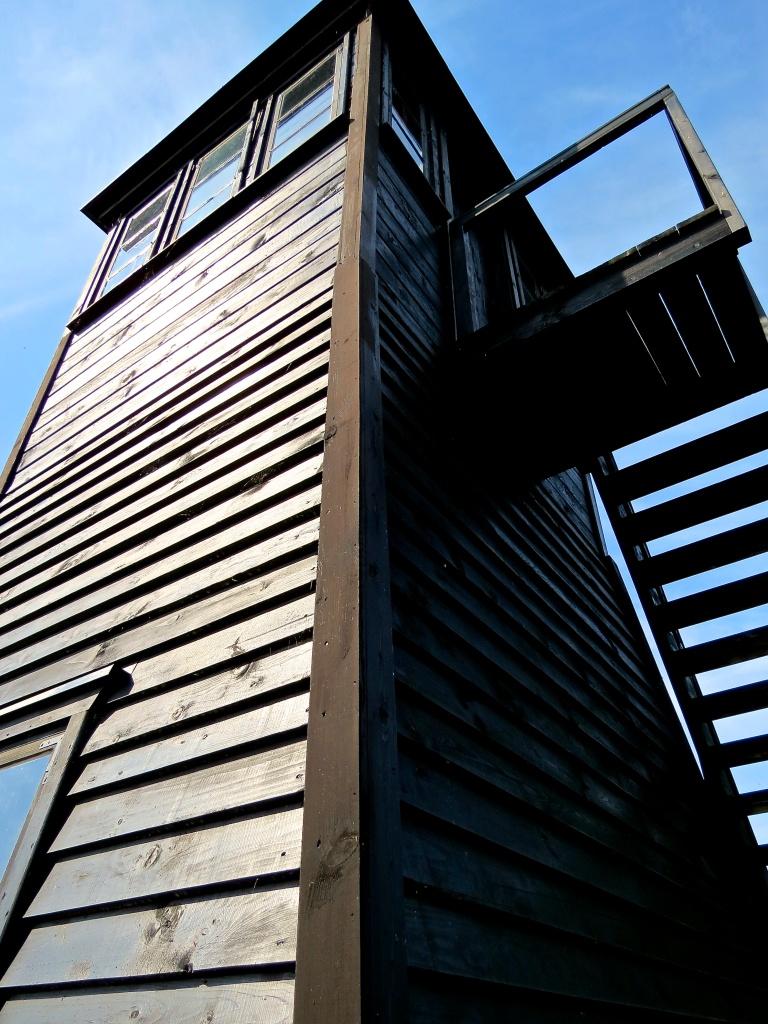 Looking up at a guard tower.