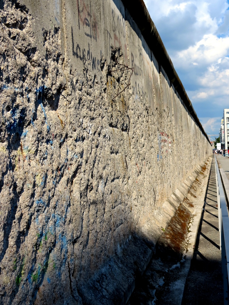 Looking down the length of the remaining piece of the Berlin Wall.