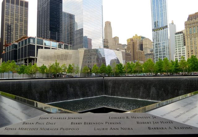 The National September 11 Museum stands watch near one of the Memorial Pools.