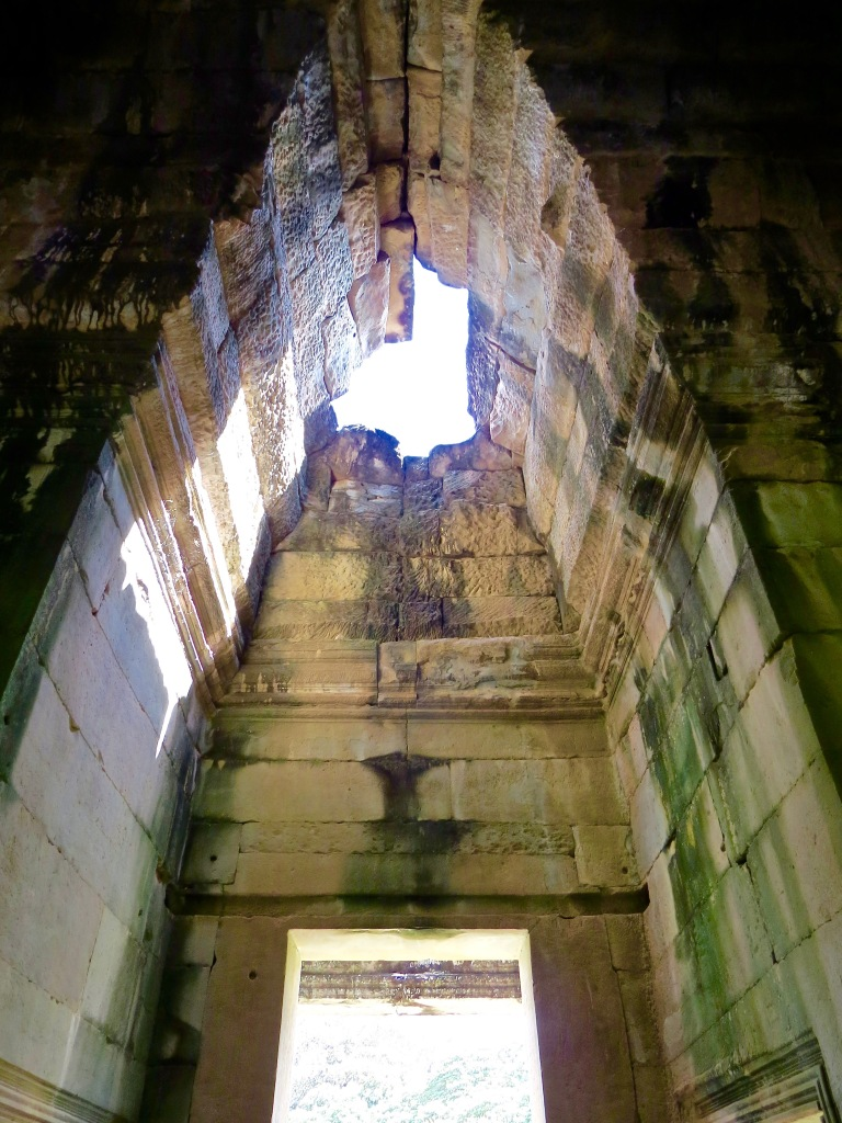Looking up in one of the entries in Angkor Wat.