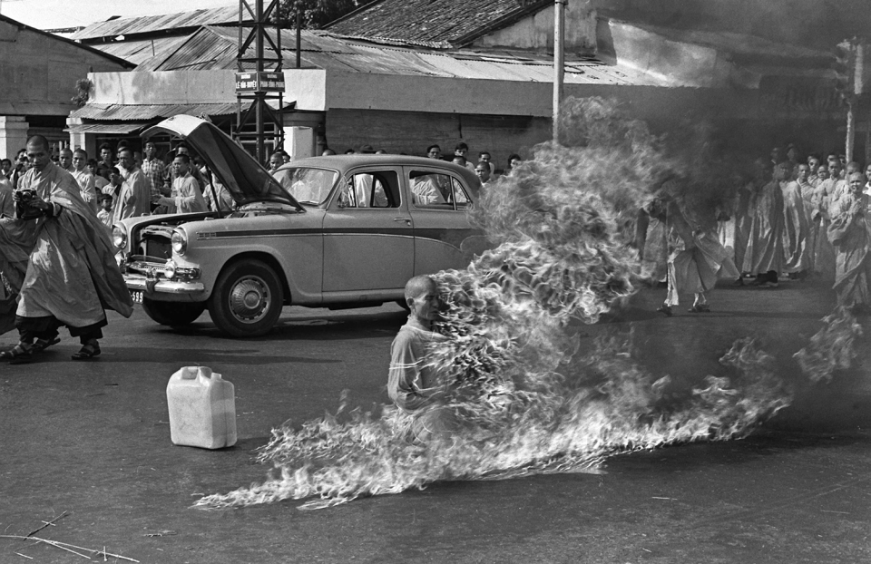 Thich Quang Duc, a Buddhist monk, burns himself to death on a Saigon street June 11, 1963 to protest alleged persecution of Buddhists by the South Vietnamese government. (AP Photo/Malcolm Browne)