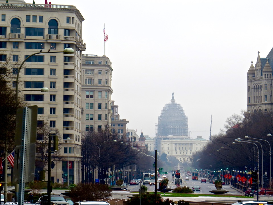 in the distance, the United States Capitol Building under renovation.