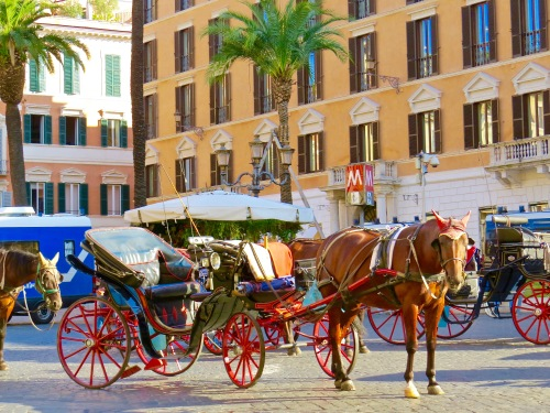 Horse and carriages lined up near the Spanish Steps.