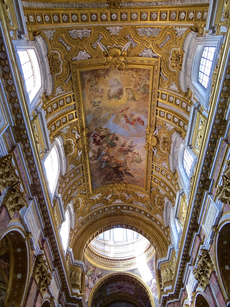 The ornate ceiling in Basilica dei SS Ambrogio E Carlo.