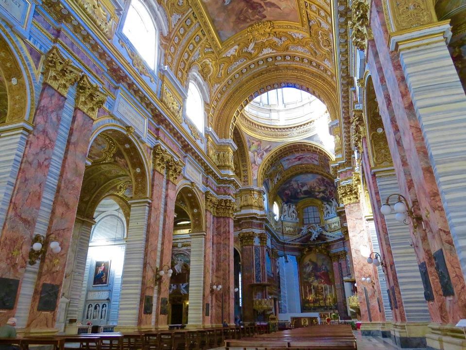 The breathtaking interior of Basilica dei SS Ambrogio E Carlo.