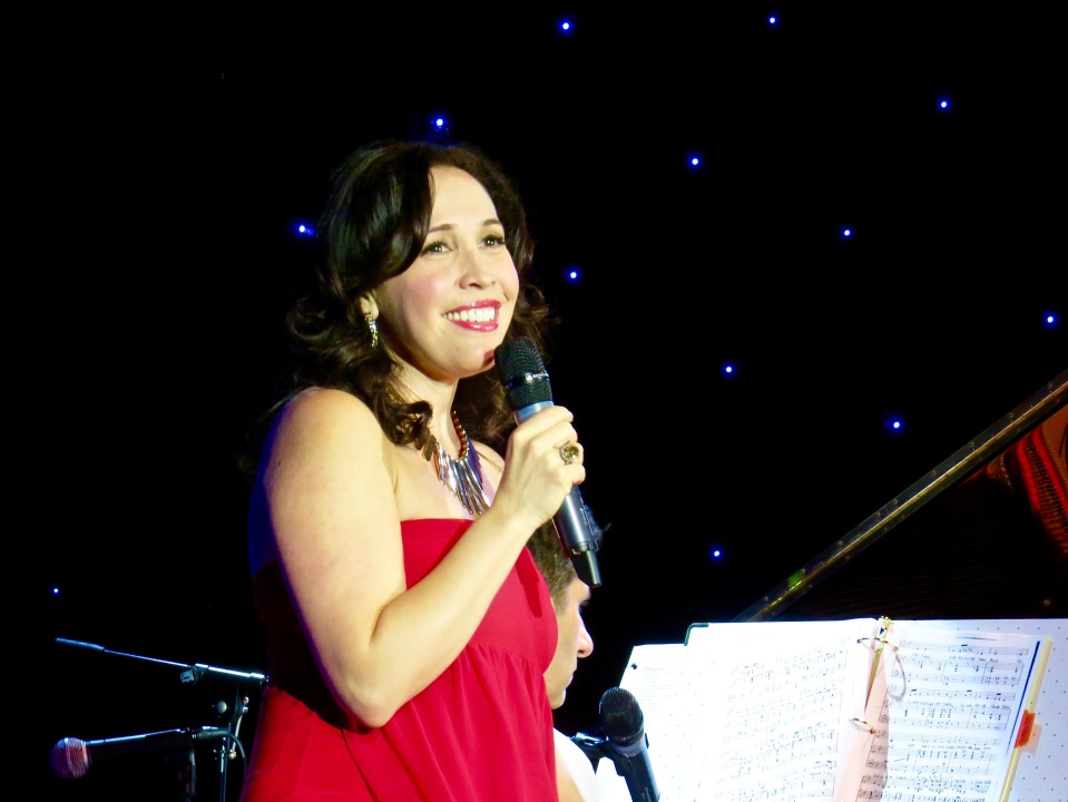 Andrea Burns with music director Seth Rudetsky in the background.