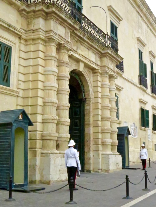 Guards at the entrance of the Grandmaster's Palace in St. George's Square.