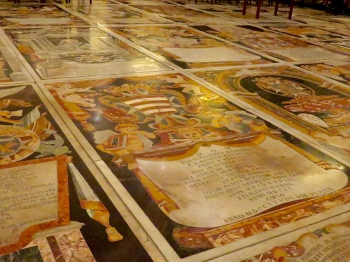The marble floor is actually a series of tombs.