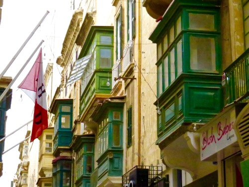 Many colorful balconies and bay windows accent the buildings in Valletta.