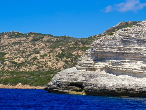 You can see where the rock of the island of Corsica changes from limestone to granite.