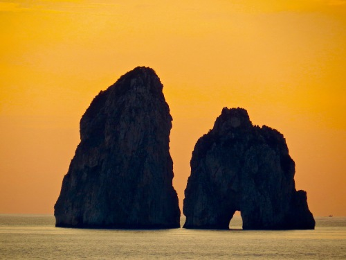 A gorgeous view as Sunset framed this rock formation jutting out of the sea.