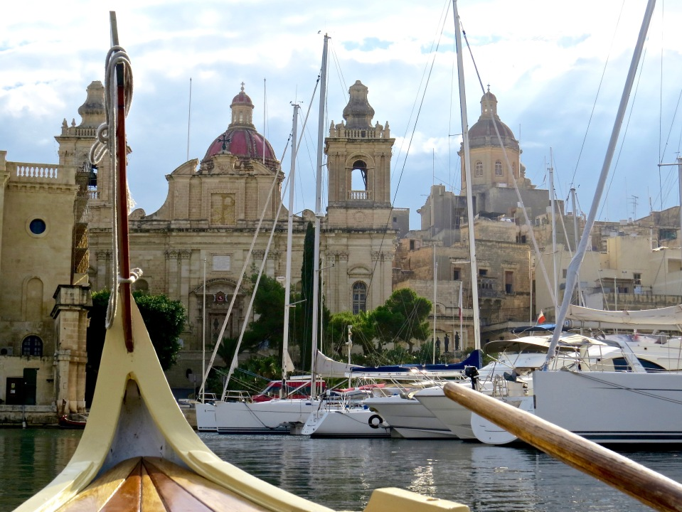 Touring the Grand Harbour in a Maltese dhaj