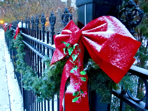 Garland and bows decorate the fence around 321 Division Street.